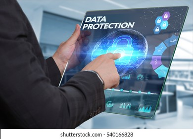 Business, Technology, Internet and network concept. Business man working on the tablet of the future, select on the virtual display: DATA PROTECTION
