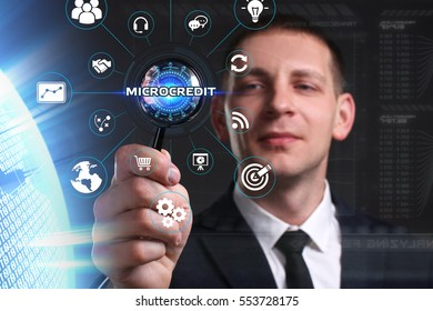 Business, Technology, Internet and network concept. Young businessman working on a virtual screen of the future and sees the inscription: microcredit
