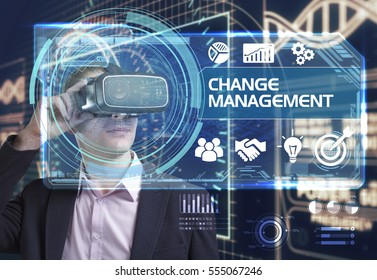 Business, Technology, Internet and network concept. Young businessman working in virtual reality glasses sees the inscription: Change management