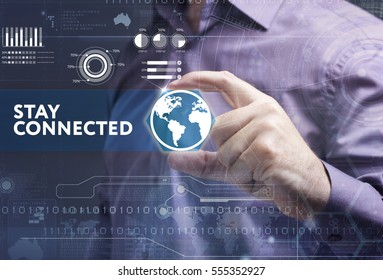 Business, Technology, Internet and network concept. Young businessman working on a virtual screen of the future and sees the inscription: stay connected