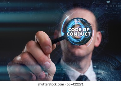 Business, Technology, Internet and network concept. Young businessman working on a virtual screen of the future and sees the inscription: code of conduct