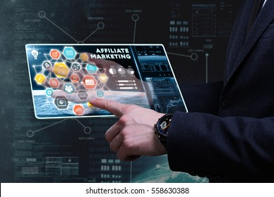 Business, Technology, Internet and network concept. Young businessman working on a tablet of the future, he sees the inscription: affiliate marketing
