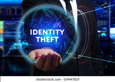 Business, Technology, Internet and network concept. Young businessman working in the field of the future, he sees the inscription: identity theft