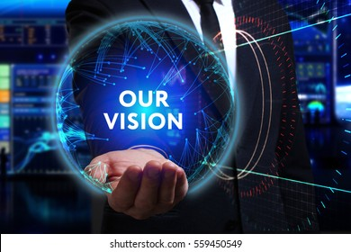 Business, Technology, Internet and network concept. Young businessman working in the field of the future, he sees the inscription: our vision