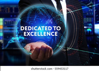 Business, Technology, Internet and network concept. Young businessman working in the field of the future, he sees the inscription: dedicated to excellence
