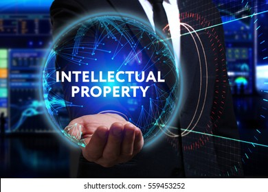 Business, Technology, Internet and network concept. Young businessman working in the field of the future, he sees the inscription: intellectual property