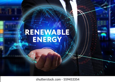 Business, Technology, Internet and network concept. Young businessman working in the field of the future, he sees the inscription: renewable energy