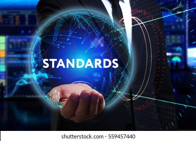 Business, Technology, Internet and network concept. Young businessman working in the field of the future, he sees the inscription: standards