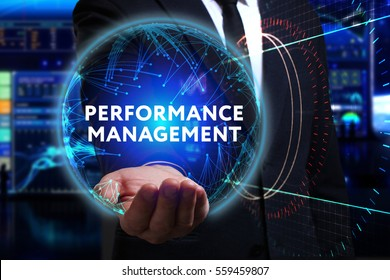Business, Technology, Internet and network concept. Young businessman working in the field of the future, he sees the inscription: performance management
