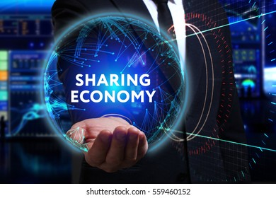 Business, Technology, Internet and network concept. Young businessman working in the field of the future, he sees the inscription: sharing economy