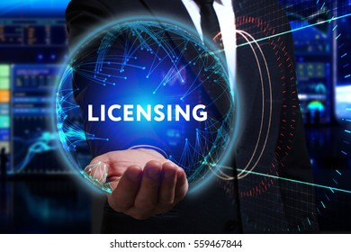Business, Technology, Internet and network concept. Young businessman working in the field of the future, he sees the inscription: licensing