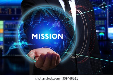 Business, Technology, Internet and network concept. Young businessman working in the field of the future, he sees the inscription: mission