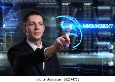 Business, Technology, Internet and network concept. Young businessman working on a virtual blackboard of the future, he sees the inscription: microcredit
