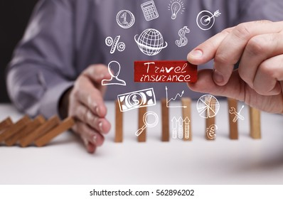 Business, Technology, Internet and network concept. Young businessman shows the word: Travel insurance