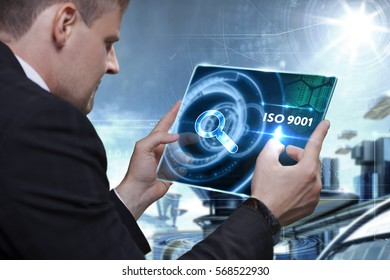 Business, Technology, Internet and network concept. Businessman working on the tablet of the future, select on the virtual display: ISO 9001
