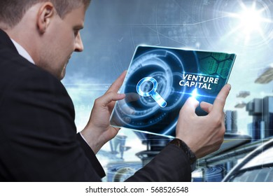 Business, Technology, Internet and network concept. Businessman working on the tablet of the future, select on the virtual display: Venture capital