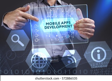 Business, Technology, Internet and network concept. Young businessman showing a word in a virtual tablet of the future: Mobile apps development