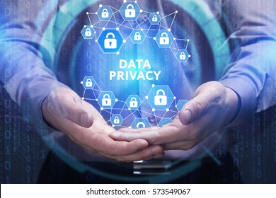 Business, Technology, Internet and network concept. Young businessman shows the word on the virtual display of the future: Data privacy