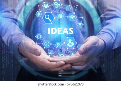 Business, Technology, Internet and network concept. Young businessman shows the word on the virtual display of the future: Ideas