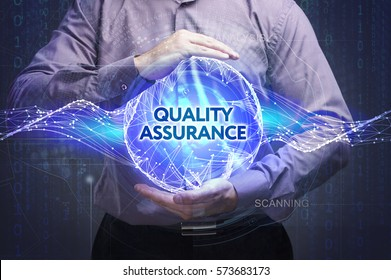 Business, Technology, Internet and network concept. Young businessman shows the word: Quality assurance