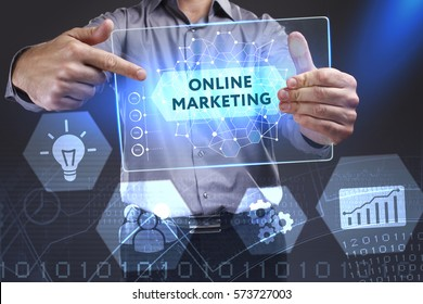 Business, Technology, Internet and network concept. Young businessman showing a word in a virtual tablet of the future: Online marketing