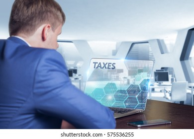 Business, Technology, Internet and network concept. Business man working on the tablet of the future, select on the virtual display: TAXES