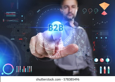 Business, Technology, Internet and network concept. Young businessman showing a word in a virtual tablet of the future: B2B