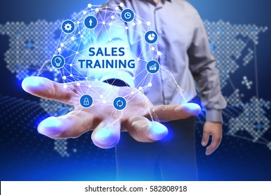 Business, Technology, Internet and network concept. Young businessman shows the word on the virtual display of the future: Sales training