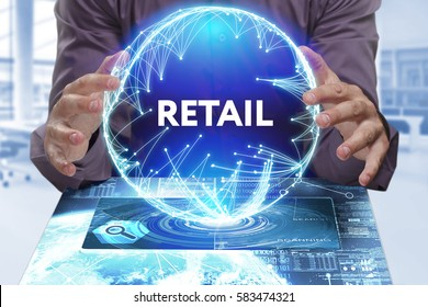Business, Technology, Internet and network concept. Young businessman shows the word on the virtual display of the future: Retail