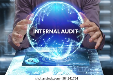 Business, Technology, Internet and network concept. Young businessman shows the word on the virtual display of the future: Internal audit