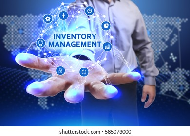 Business, Technology, Internet and network concept. Young businessman shows the word on the virtual display of the future: Inventory management