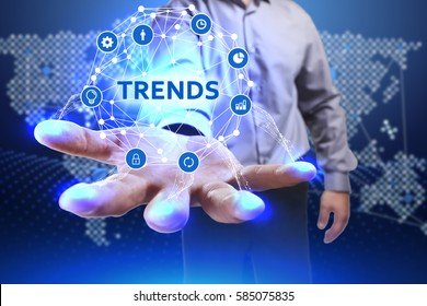 Business, Technology, Internet and network concept. Young businessman shows the word on the virtual display of the future: Trends