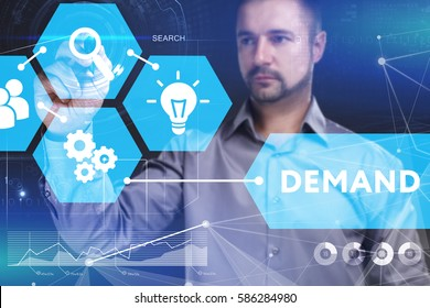 Business, Technology, Internet and network concept. Young businessman shows the word on the virtual display of the future: Demand