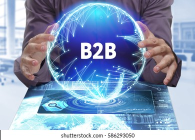 Business, Technology, Internet and network concept. Young businessman shows the word on the virtual display of the future: B2B