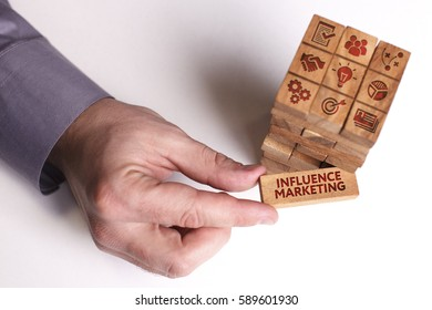 Business, Technology, Internet and network concept. Young businessman shows the word: Influence marketing