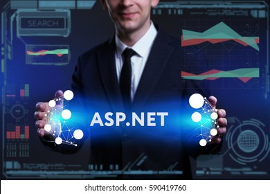 Business, Technology, Internet and network concept. Young businessman working on a virtual screen of the future and sees the inscription: ASP.NET