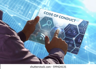 Business, Technology, Internet and network concept . Young business man working on the tablet of the future , select the virtual screen: Code of conduct