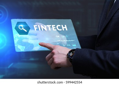 Business, Technology, Internet and network concept. Young businessman working on a virtual screen of the future and sees the inscription: Fintech