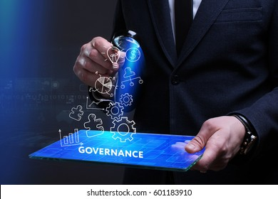 Business, Technology, Internet and network concept. Young businessman working on a virtual screen of the future and sees the inscription: Governance