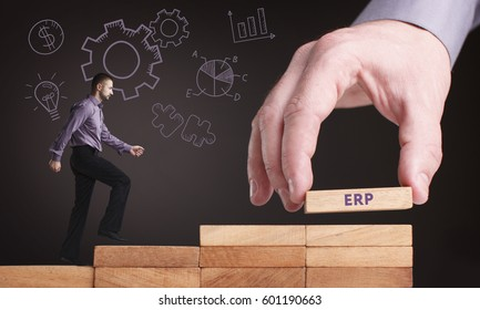 Business, Technology, Internet and network concept. Young businessman shows the word: ERP