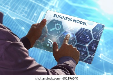 Business, Technology, Internet and network concept . Young business man working on the tablet of the future , select the virtual screen: Business model