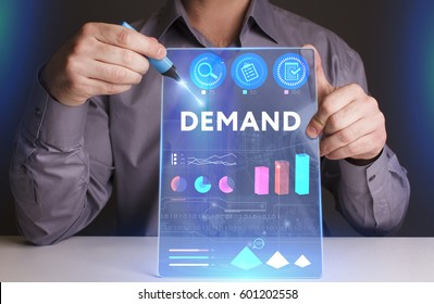 Business, Technology, Internet and network concept. Young businessman working on a virtual screen of the future and sees the inscription: Demand