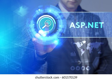 Business, Technology, Internet and network concept. Business man working on the tablet of the future, select on the virtual display: ASP.NET