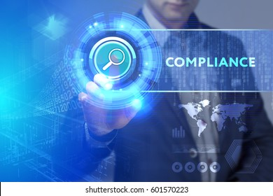 Business, Technology, Internet and network concept. Business man working on the tablet of the future, select on the virtual display: Compliance