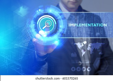 Business, Technology, Internet and network concept. Business man working on the tablet of the future, select on the virtual display: Implementation