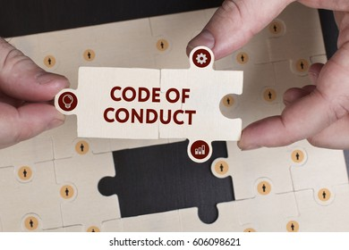 Business, Technology, Internet and network concept. Young businessman shows the word: Code of conduct