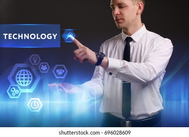 Business, Technology, Internet and network concept. Young businessman working on a virtual screen of the future and sees the inscription: Technology