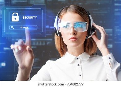 Business, Technology, Internet and network concept. Technology future. Young businesswoman working in virtual glasses, select the icon security on the virtual display.