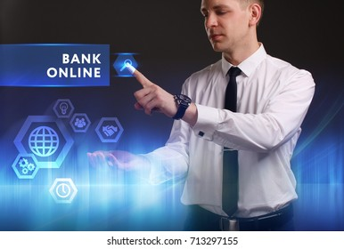 Business, Technology, Internet and network concept. Young businessman working on a virtual screen of the future and sees the inscription: Bank online