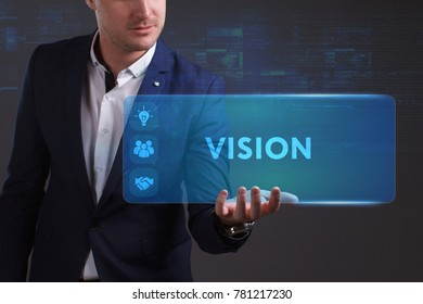 Business, Technology, Internet and network concept. Young businessman working on a virtual screen of the future and sees the inscription: Vision